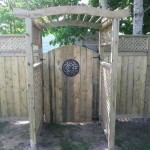 Western red cedar and pressure treated lumber - wood arbour install Ottawa