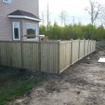 Western red cedar and pressure treated lumber - wood fence install Ottawa