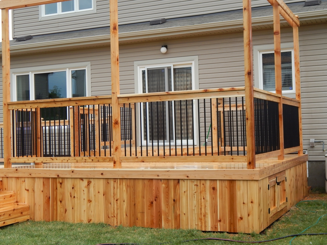 Decks pergolas sheds ottawa for Brown treated deck boards